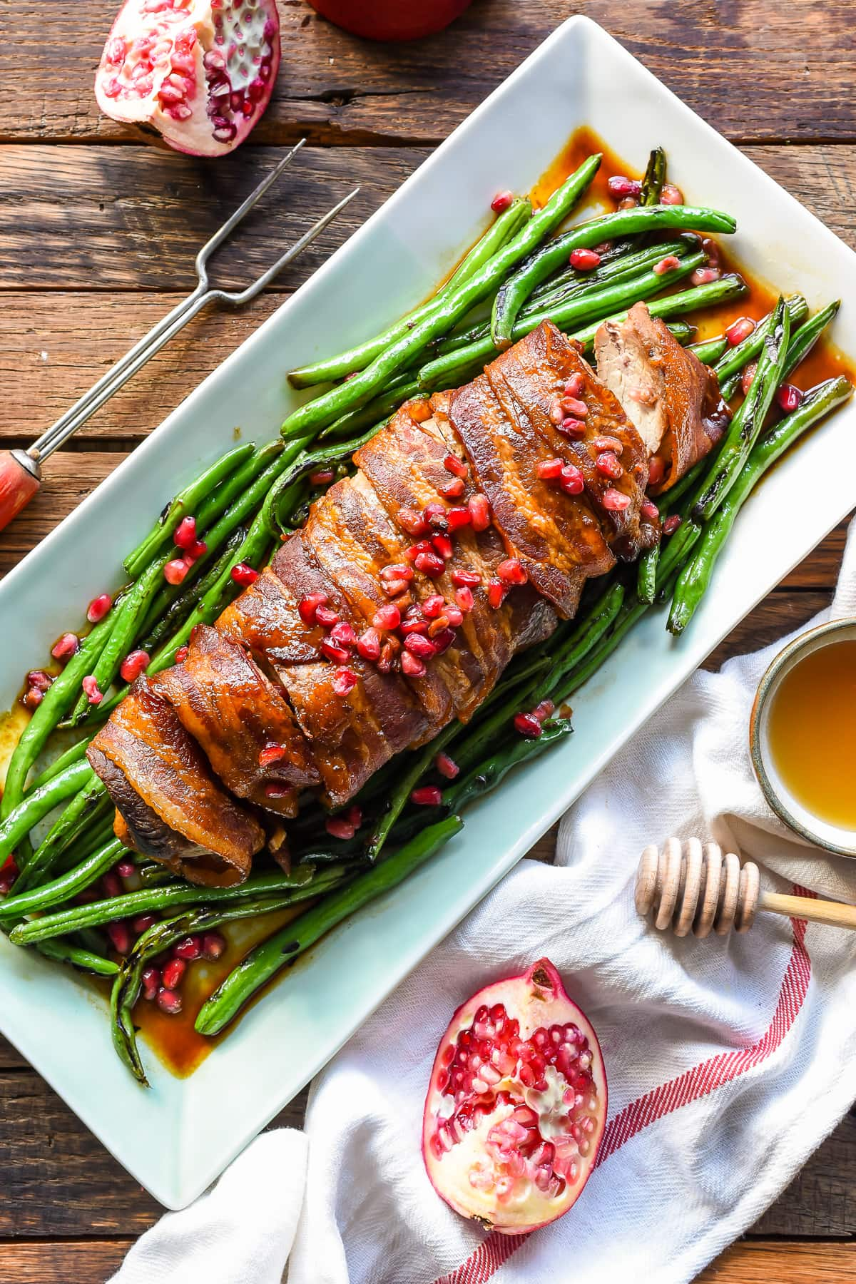 This Bacon Wrapped Pork Tenderloin is an EASY main dish for your holiday entertaining!
