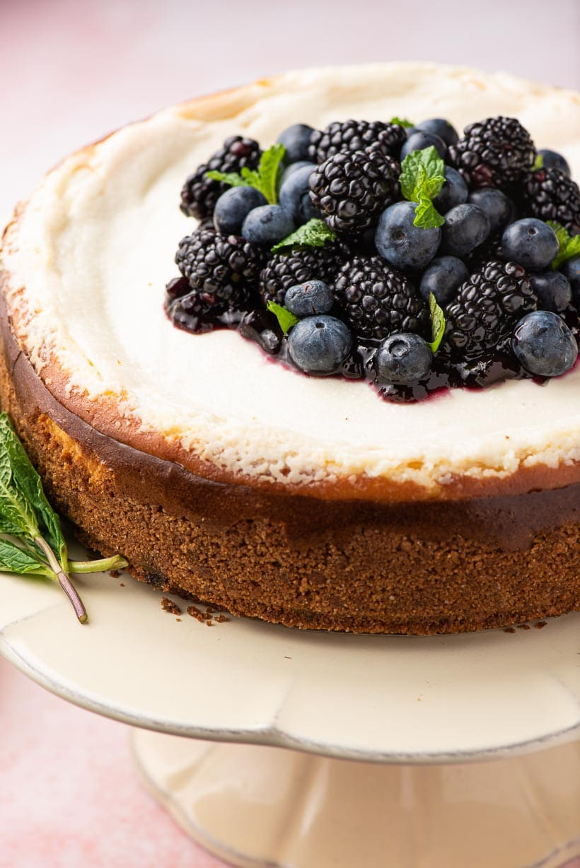 sour cream cheesecake topped with berries and mint