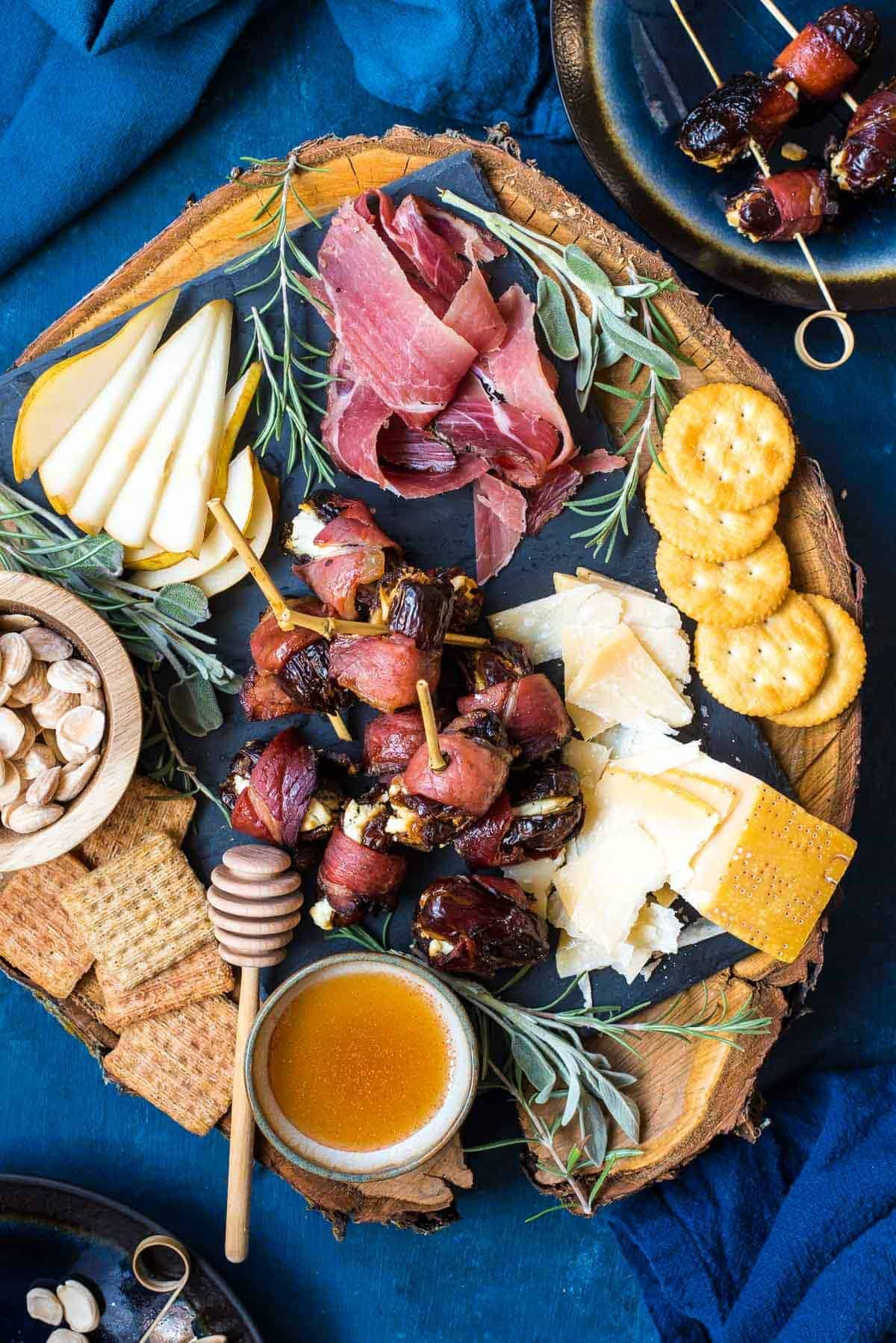 These Speck Wrapped Goat Cheese Dates make a perfect sweet and savory appetizer for the holidays!