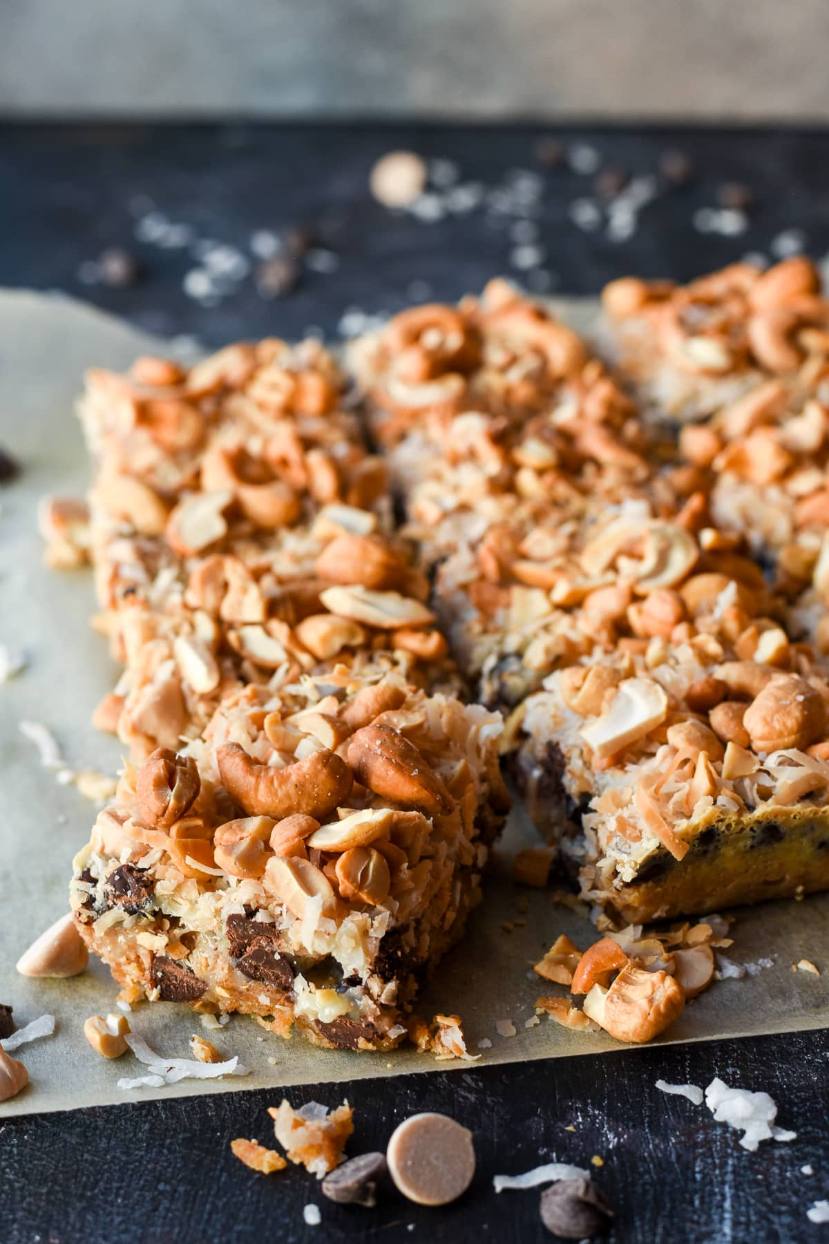 7 Layer Magic Bars are stacked with chocolate, caramel, coconut, and cashews for a rich dessert everyone will love!