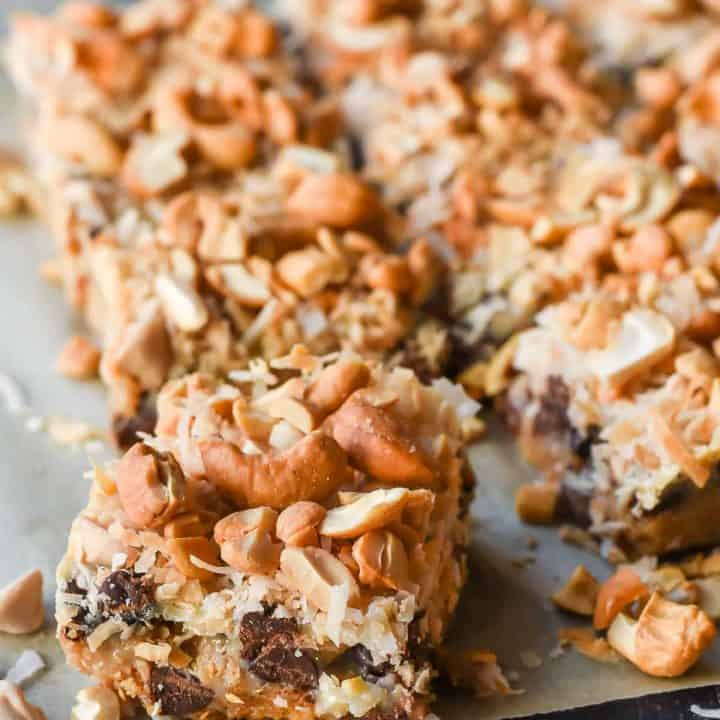 Classic 7 Layer Magic Bars made with chocolate, caramel, coconut, and cashews.