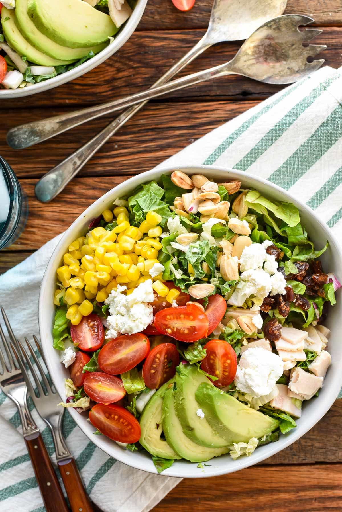 Make restaurant quality salads at home with this Copycat Northstar Chopped Salad loaded with dates, goat cheese, avocado, and corn!