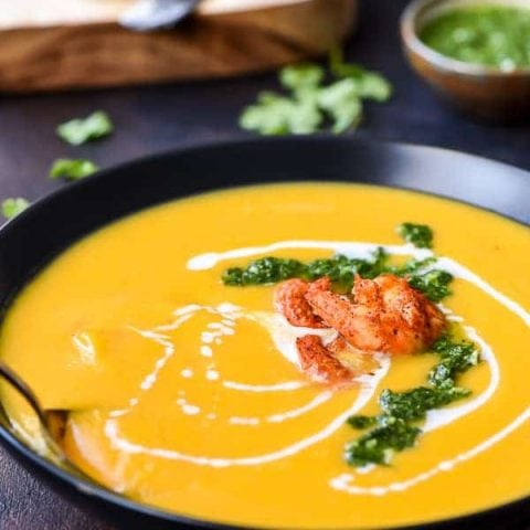 Roasted Butternut Squash Soup in a bowl with a spoon
