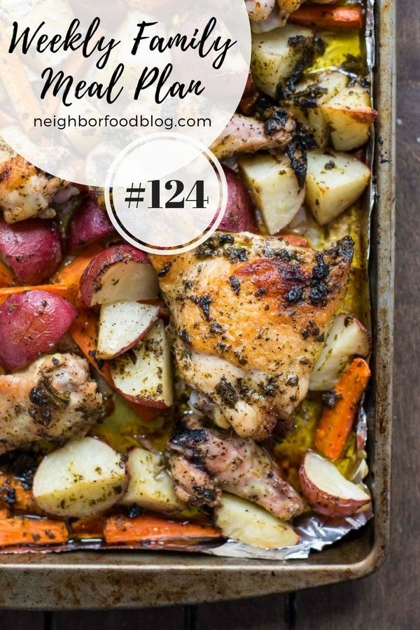 Chicken thighs potatoes and carrots on a sheet pan