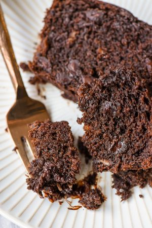Bite of chocolate banana bread on a fork