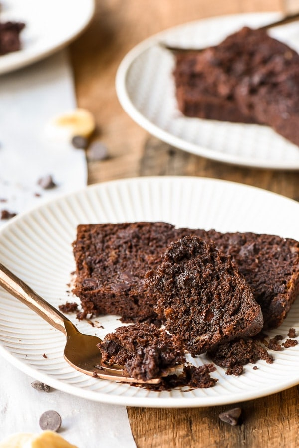 Two slices of chocolate chocolate chip banana bread on a plate