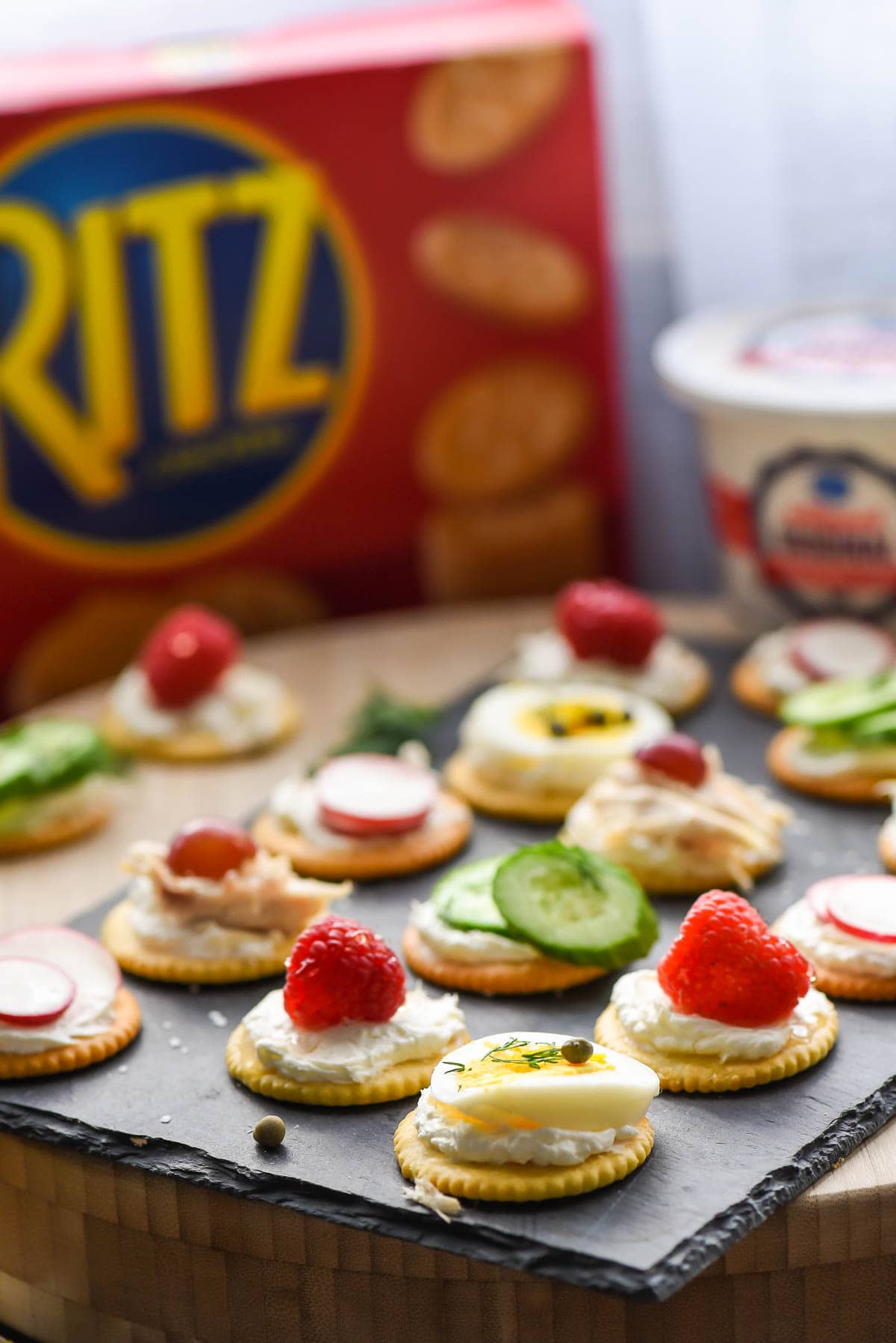 Ritz crackers topped with cream cheese and sweet and savory toppings