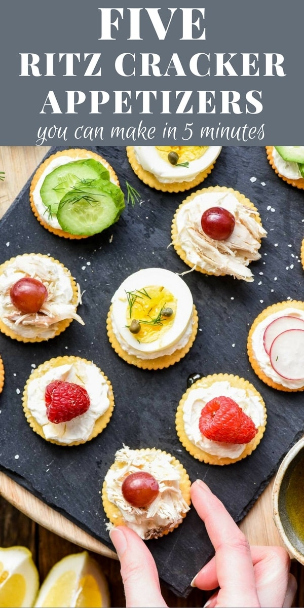 Ritz crackers topped with cream cheese, veggies, and fruits