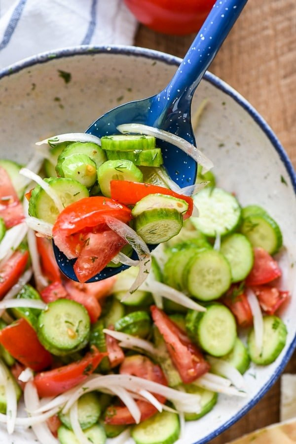 Cucumbers, Tomatoes, and Onions in a bowl with marinade