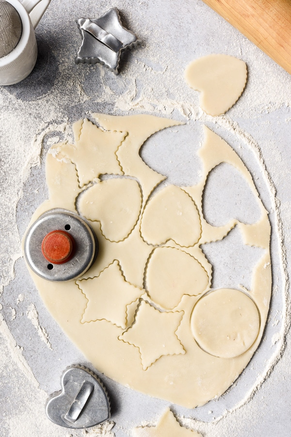 Pie dough with cookie cutter shapes cut out