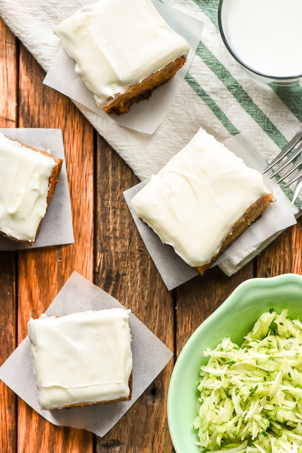 Slices of Zucchini Cake with Cream Cheese Frosting with shredded zucchini