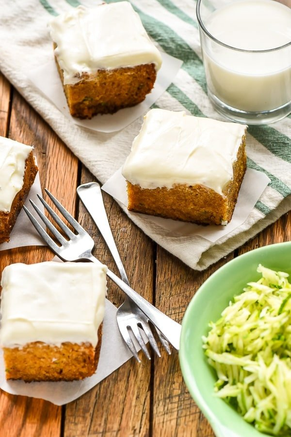 Slices of Zucchini Cake with Cream Cheese Frosting with forks