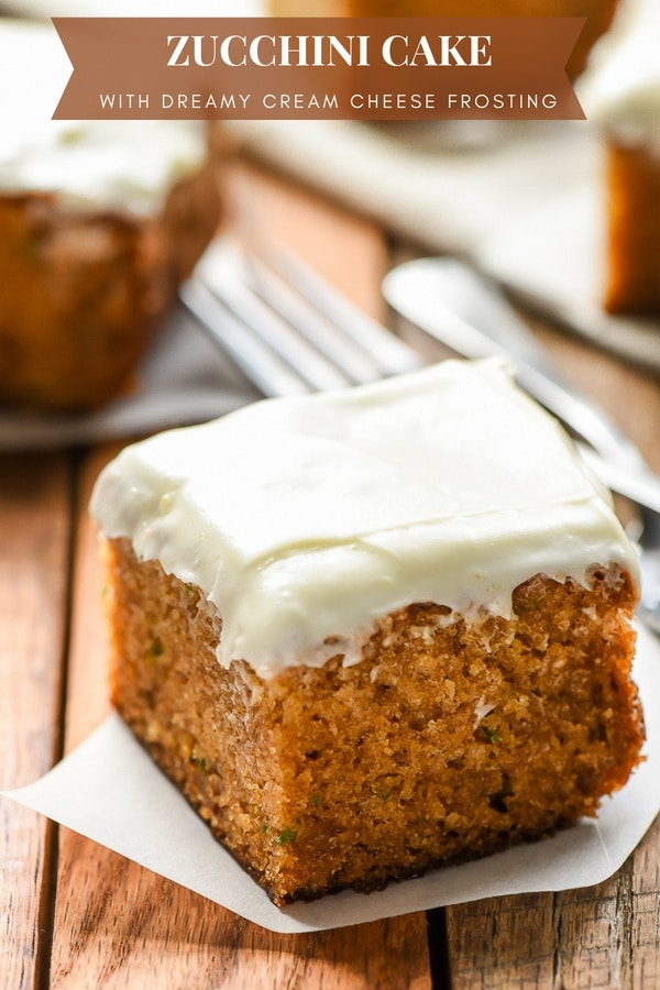 slice of zucchini cake with thick cream cheese frosting