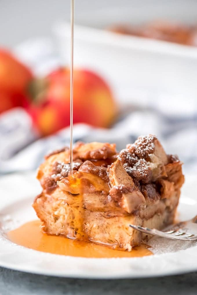Overnight Apple French Toast Casserole with syrup pouring on top