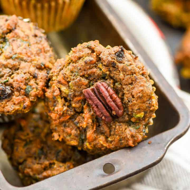 Close up of Carrot Zucchini Muffins with a pecan on top
