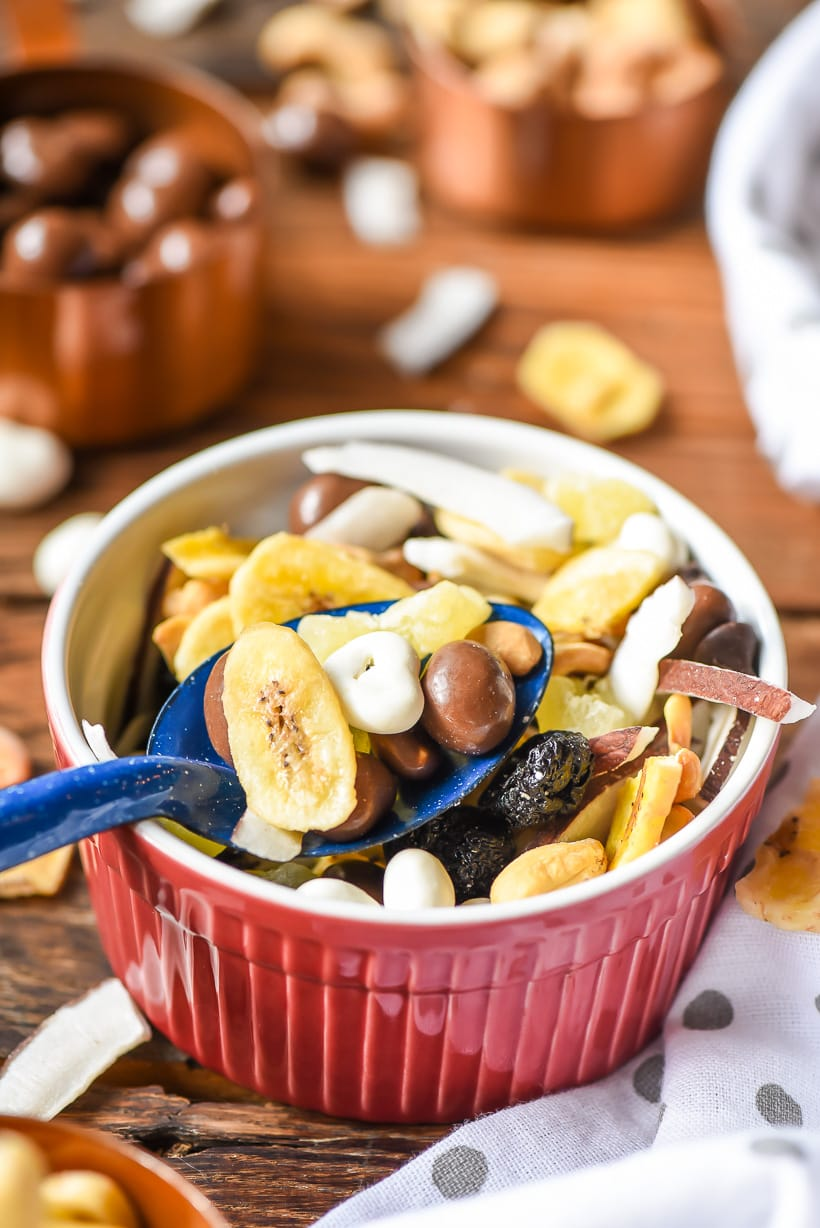 Chunky Monkey Trail Mix in a bowl with spoon