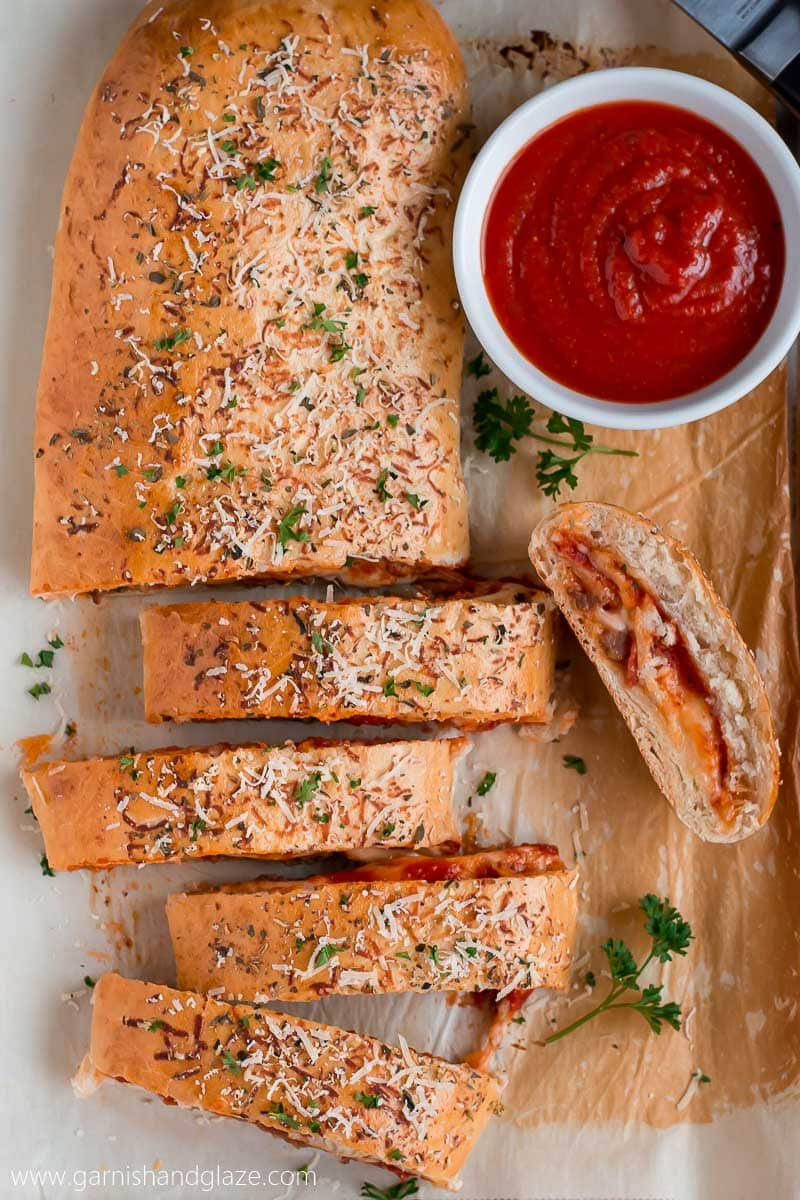 Pepperoni Sausage Stromboli slices with marinara sauce