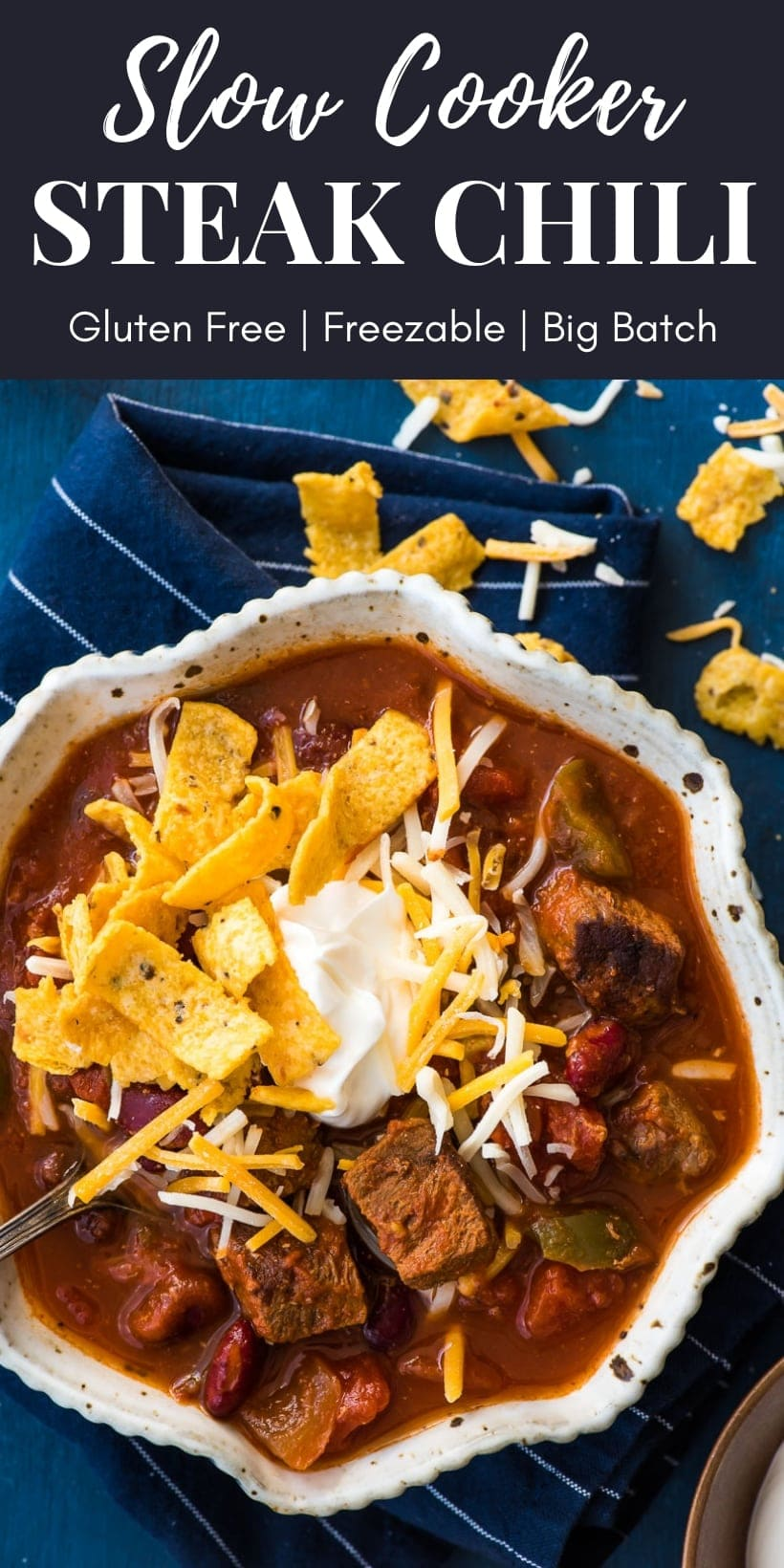 Slow Cooker Steak Chili topped with sour cream, cheese, and fritos.
