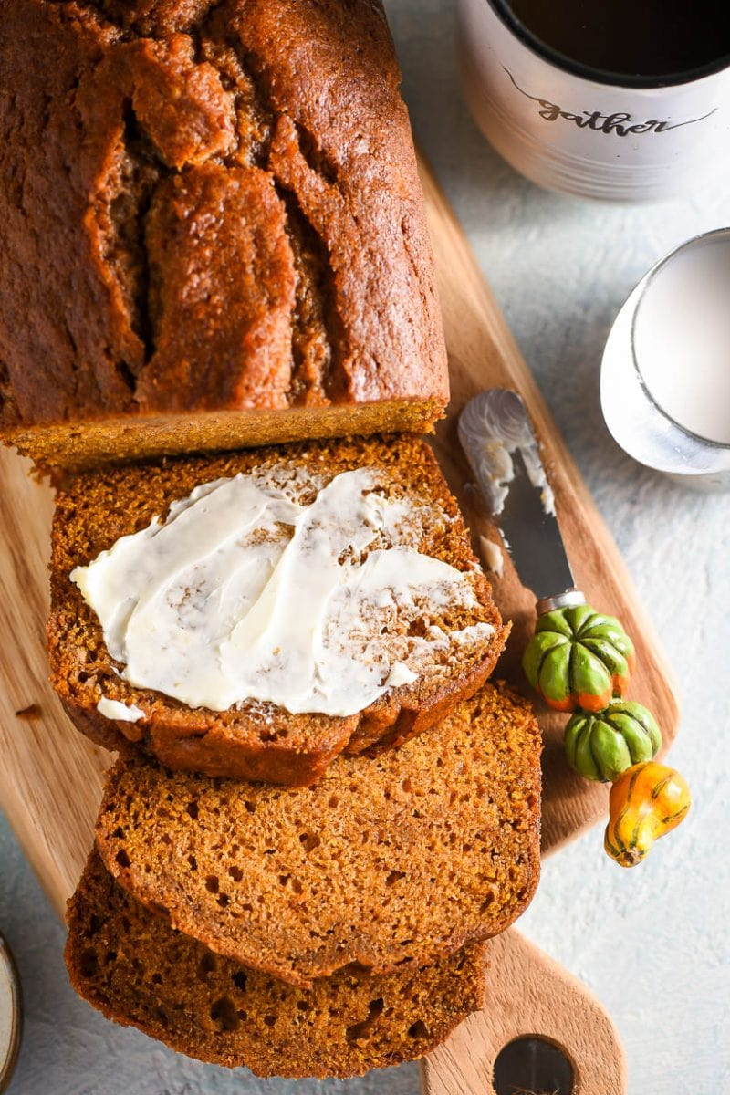 Easy Pumpkin Bread sliced with butter