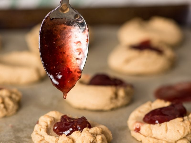 Peanut Butter Thumbprint cookies with a spoonful of raspberry jam