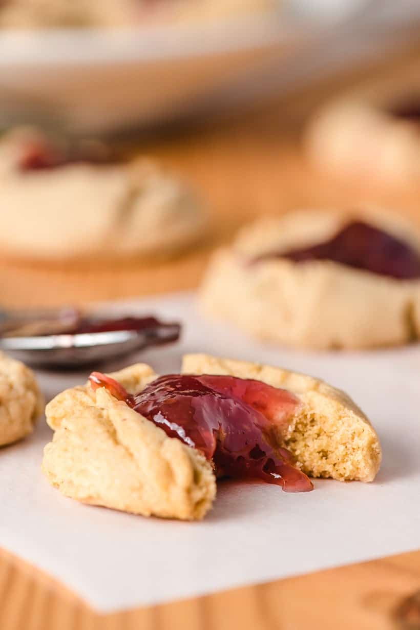 peanut butter thumbprint cookies with a bite taken out