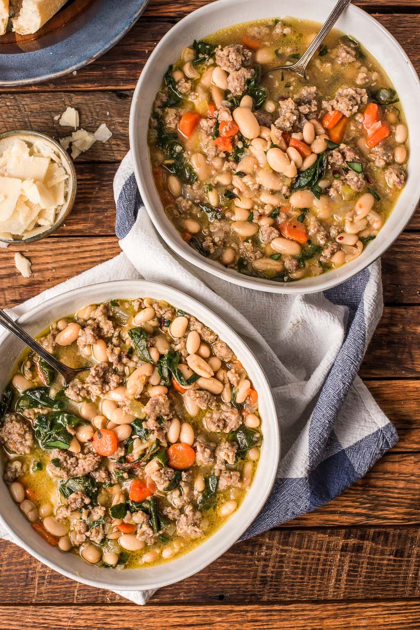 two bowls of Italian Sausage Stew with greens and white beans