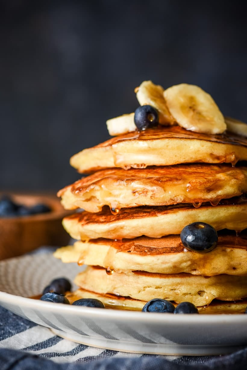 stack of ricotta pancakes with blueberries and bananas