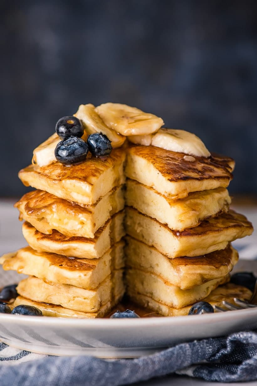 Ricotta pancakes stack with wedge cut out of the center