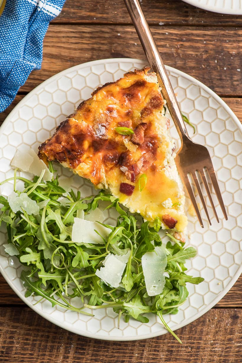 Crustless Quiche Lorraine slice with simple arugula salad