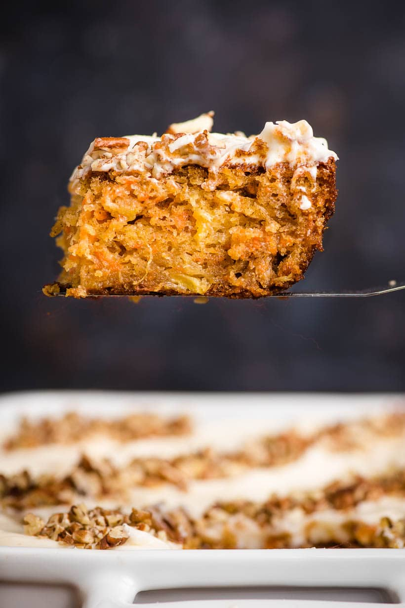 Slice of carrot sheet cake on a spatula