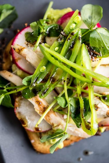 Avocado Toast with Radish, Chicken, and Peas close up