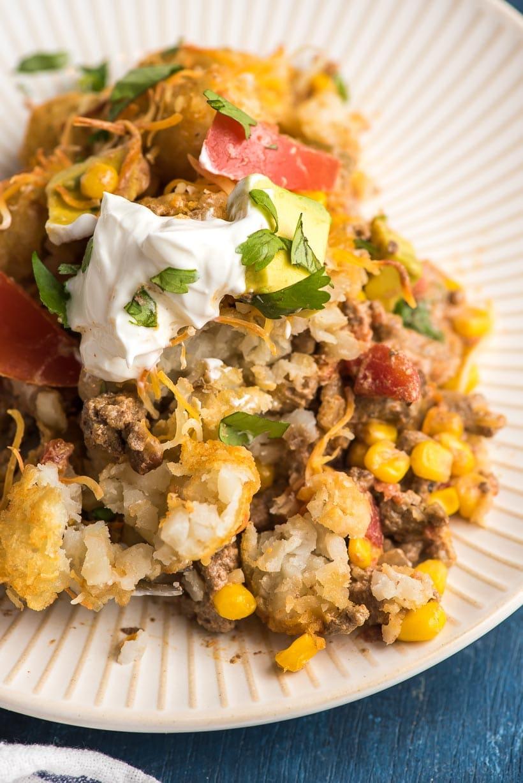Big scoop of Taco Tater Tot Casserole
