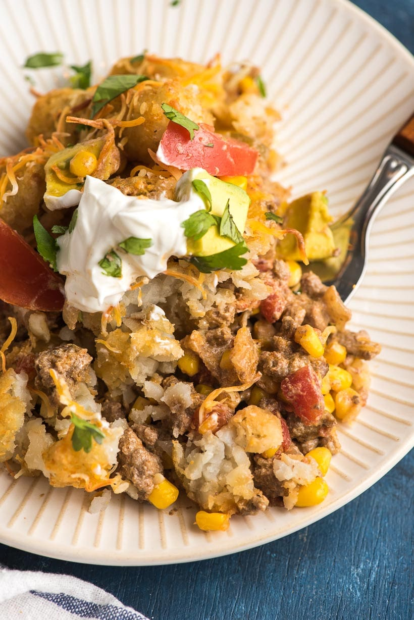 Scoop of taco tater tot casserole on plate