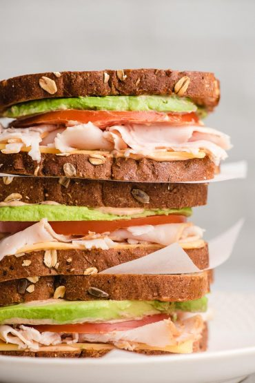 Stack of three turkey avocado sandwiches
