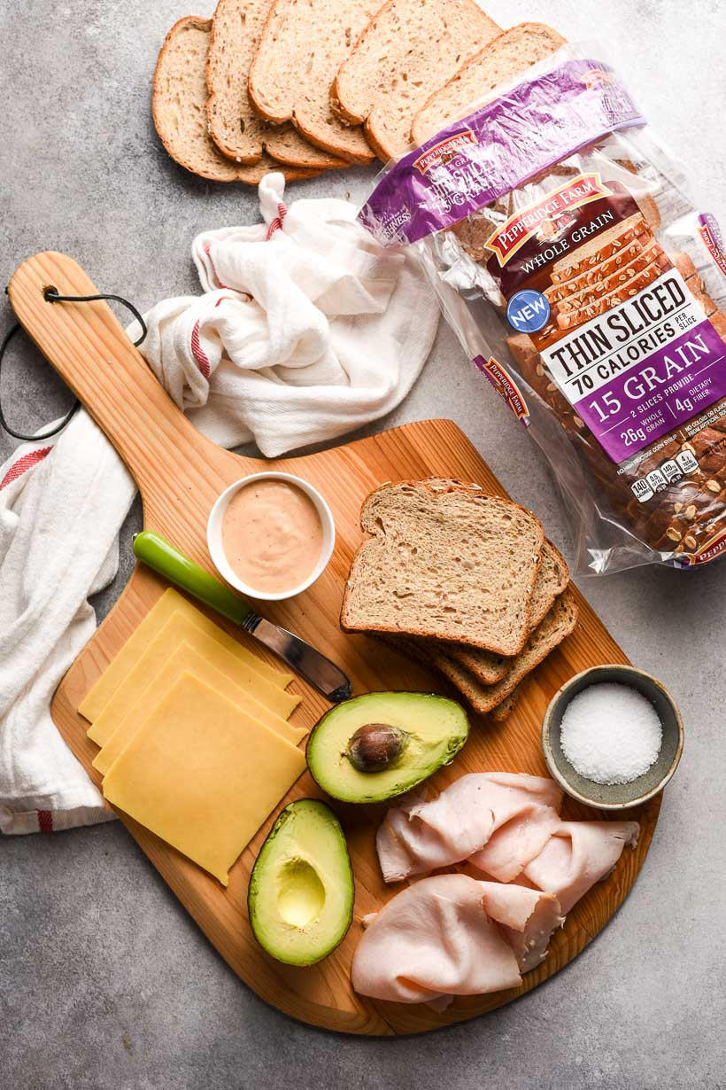 Turkey Avocado Sandwich ingredients on a cutting board