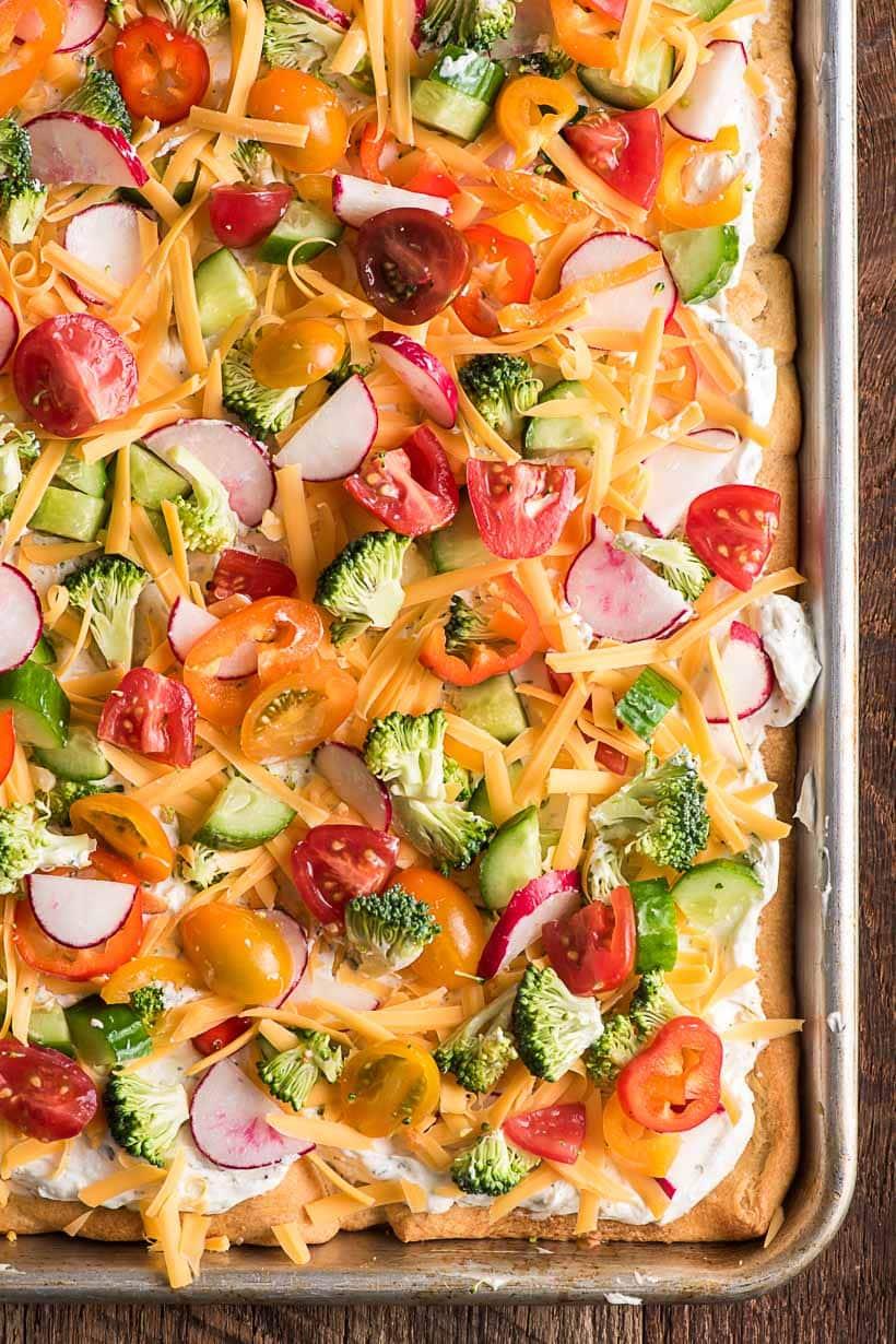 veggie pizza in a large half sheet pan