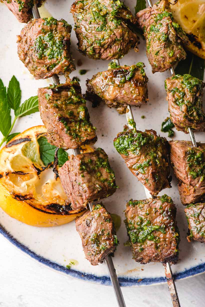 Grilled Beef Skewers on a white plate