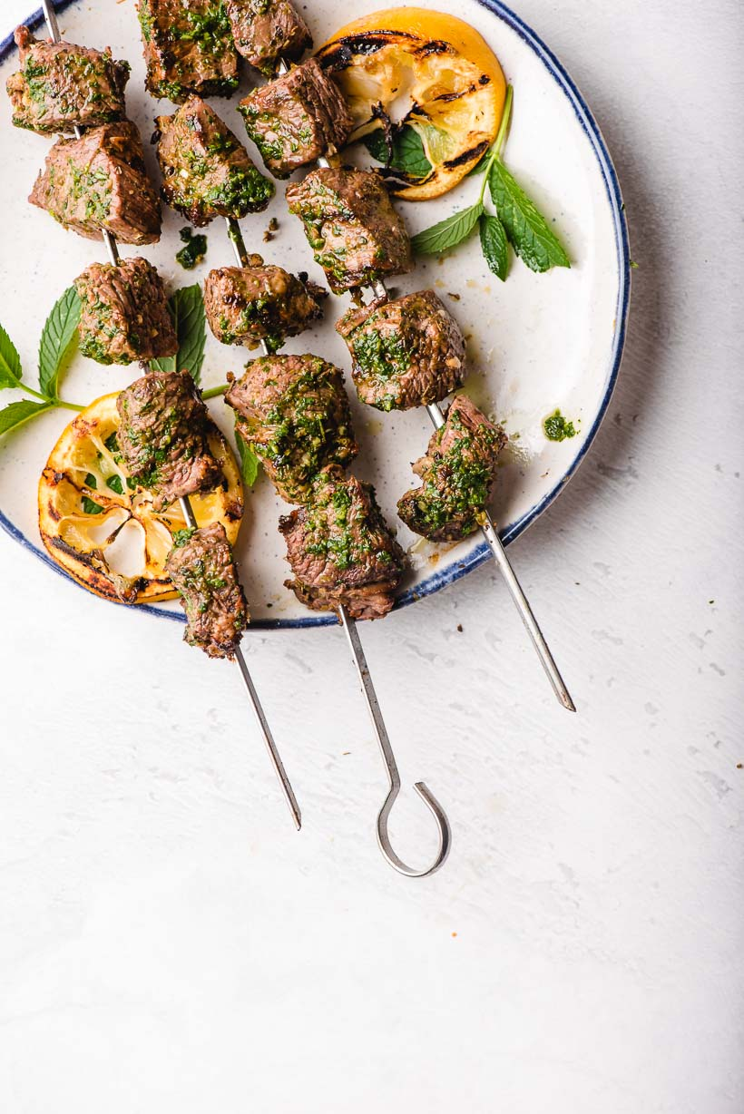 3 Beef Kabobs on metal skewers with grilled lemon slices