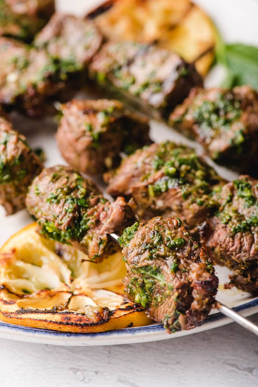 Beef Kabobs with basil mint chimichurri sauce on top