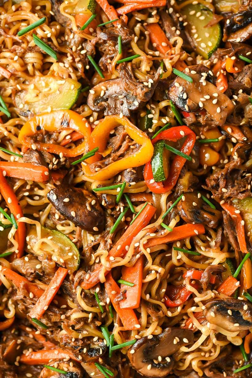 Up close image of ramen stir fry with beef, mushrooms, and peppers