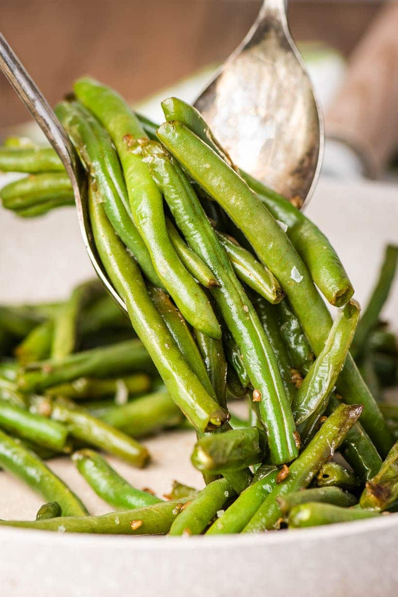 Garlic Green Beans being served out of a skillet
