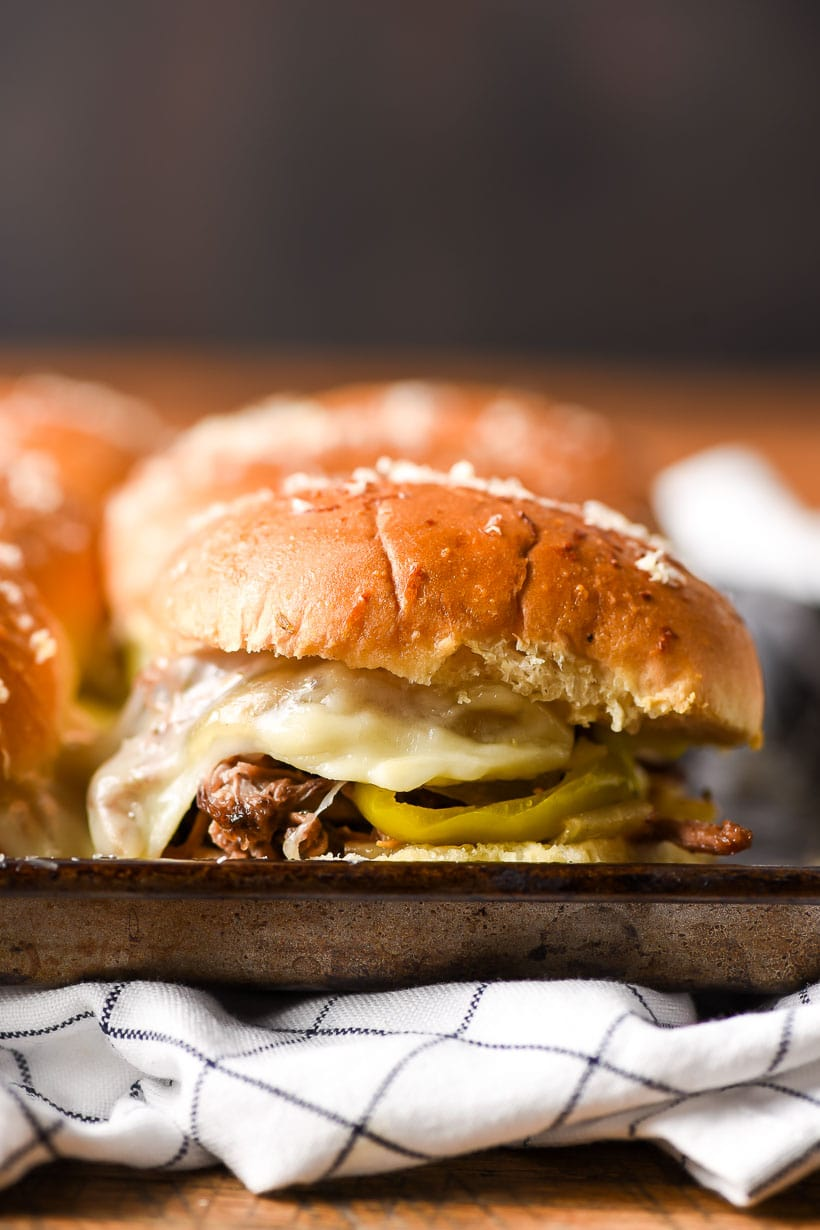 closeup of an oven toasted pulled beef slider sandwich