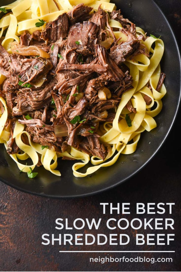 This Slow Cooker Shredded Beef is juicy, tender, and so flavorful! This big batch recipe is perfect for making multiple meals. Try it over pasta, in tacos, in enchiladas, or on sliders! #shreddedbeef #crockpotrecipe