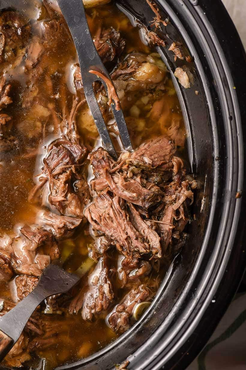 shredded beef in a slow cooker