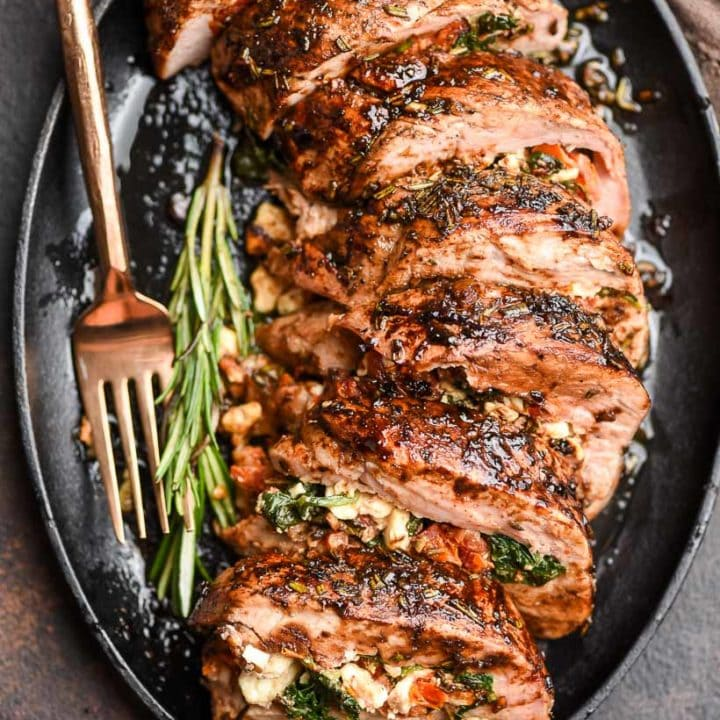 Stuffed Pork Tenderloin served in an iron skillet