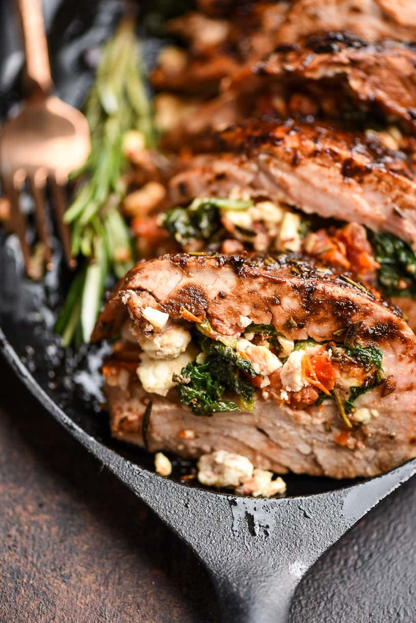 Closeup of stuffed pork tenderloin served on a skillet