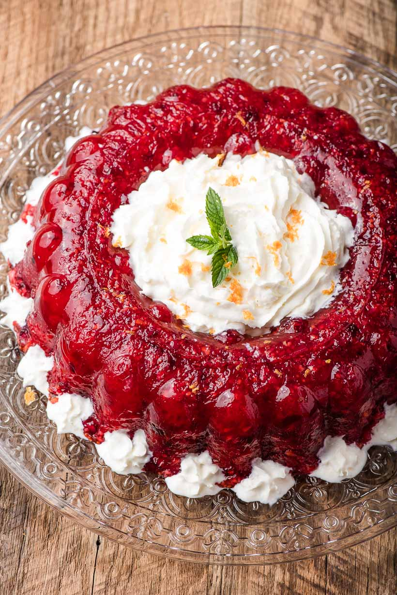 Raspberry Cranberry Jello Salad on a glass platter