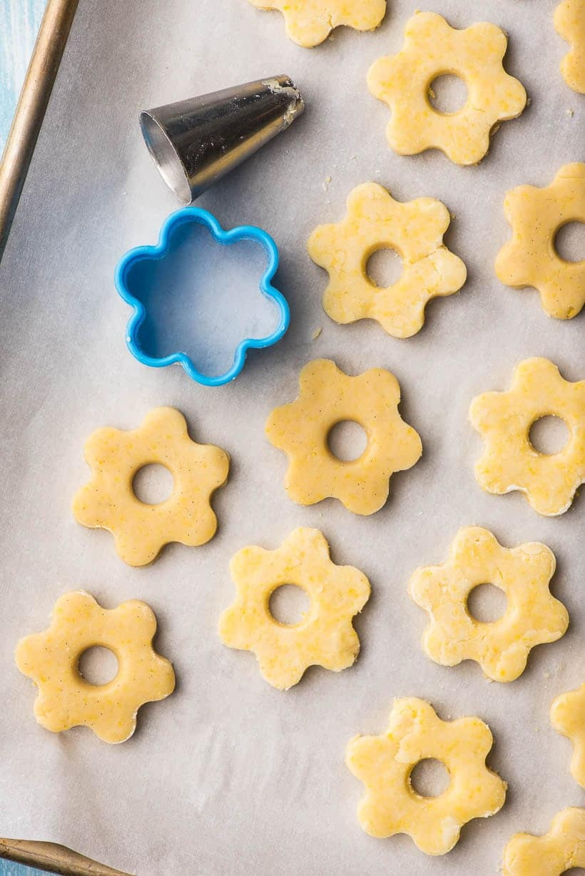 Canestrelli flower cookies on a baking sheet