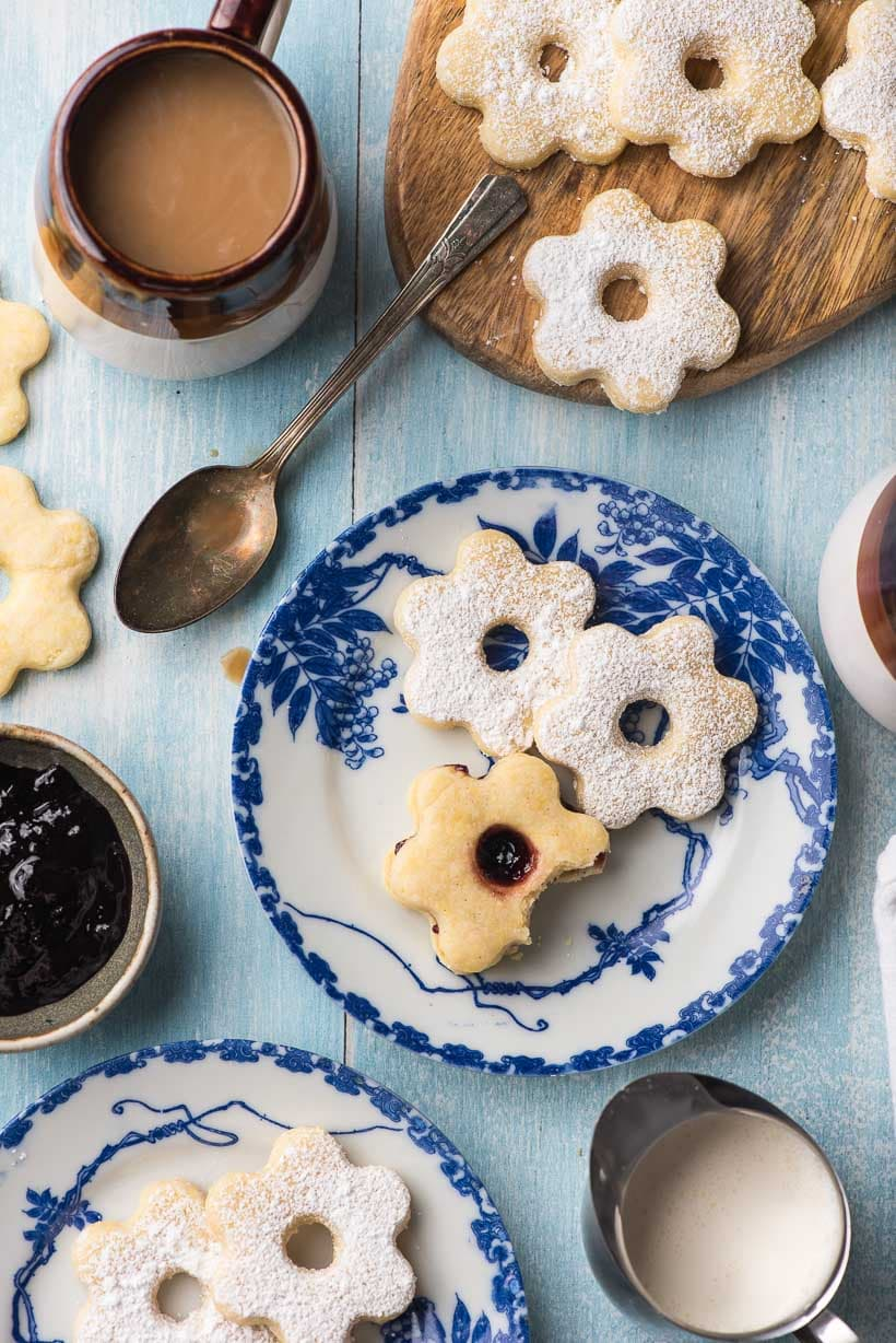 Canestrelli cookies on a plate with coffee and jam