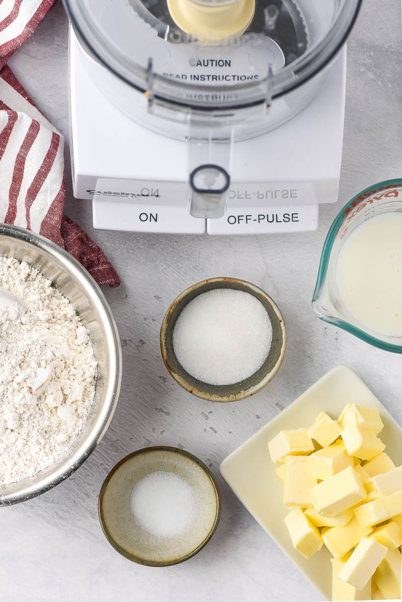 ingredients for homemade pie crust beside a food processor